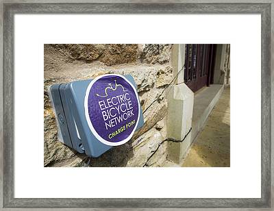An Electric Bike Recharging Point Framed Print by Ashley Cooper