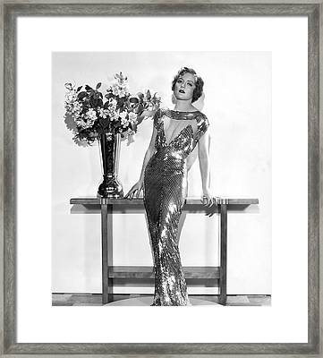 An Elegant Evening Gown Framed Print by Underwood Archives
