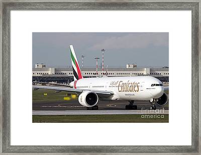 An Emirates Boeing 777 At Milano Framed Print by Luca Nicolotti