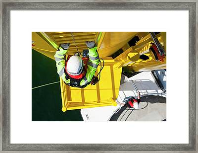 An Engineer Descends A Transition Piece Framed Print by Ashley Cooper