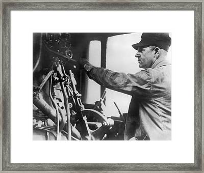 An Engineer In A Locomotive Framed Print by Underwood Archives