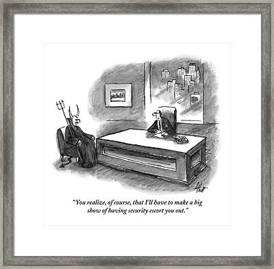 An Executive Sitting At A Desk Is Speaking Framed Print