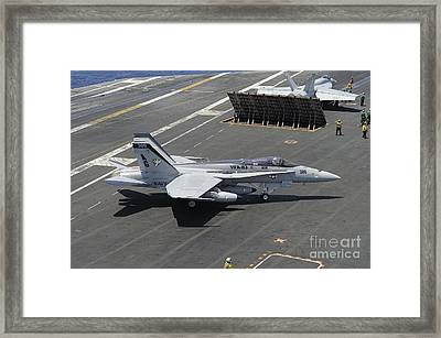 An Fa-18 Hornet Of The U.s. Navy Aboard Framed Print by Remo Guidi