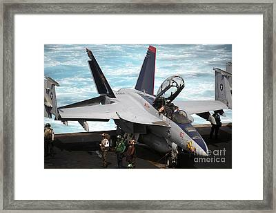 An Fa-18f Super Hornet Sits Framed Print by Stocktrek Images