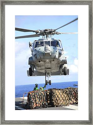 An Hh-60h Sea Hawk Helicopter Picks Framed Print