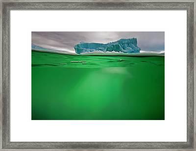 An Iceberg In Green Water Near Peterman Framed Print by David Doubilet
