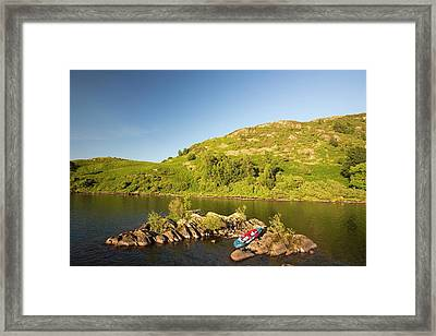 An Inflatable Kayak On Ullswater Framed Print by Ashley Cooper