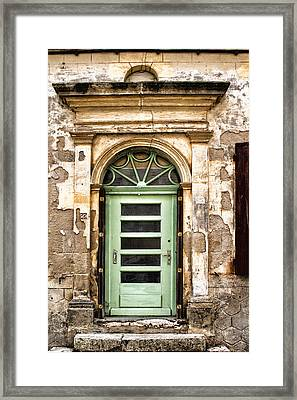 An Intriguing Green Door Framed Print