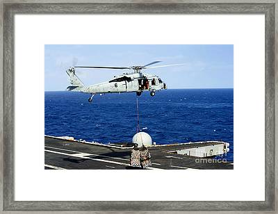 An Mh-60r Seahawk Helicopter Places Framed Print