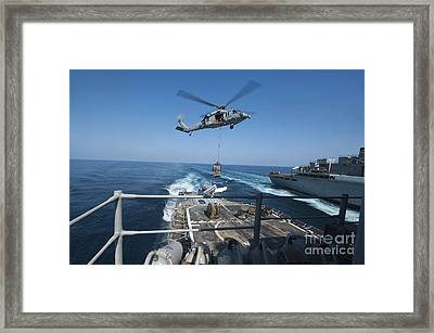An Mh-60s Sea Hawk Brings Pallets Framed Print by Stocktrek Images