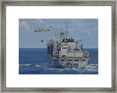 An Mh-60s Sea Hawk Conducts A Vertical Framed Print by Stocktrek Images