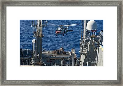 An Mh-60s Sea Hawk Delivers Supplies Framed Print by Stocktrek Images