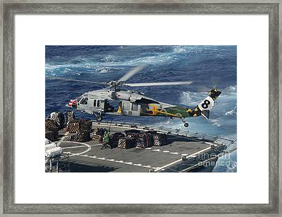 An Mh-60s Sea Hawk Helicopter Picks Framed Print