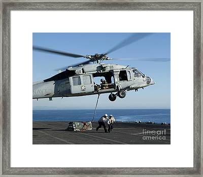 An Mh-60s Sea Hawk Helicopter Prepares Framed Print by Stocktrek Images