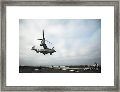 An Mv-22 Osprey Is Guided Onto Framed Print by Stocktrek Images