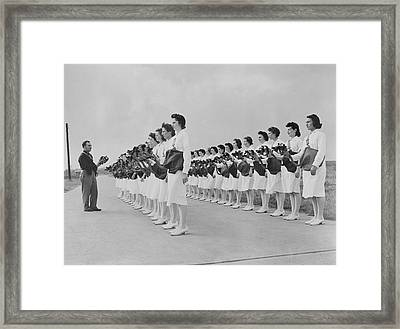 An Officer Demonstrating How To Put Framed Print by Stocktrek Images