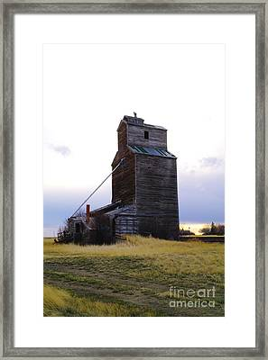 An Old Grain Elevator Off Highway Two In Montana Framed Print by Jeff Swan