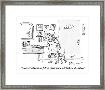 An Old Lady Speaks On The Phone In Her House Framed Print