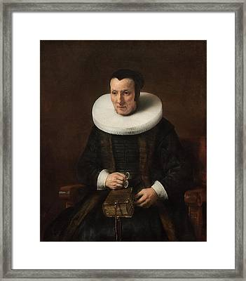An Old Lady With A Book Framed Print by Rembrandt van Rijn