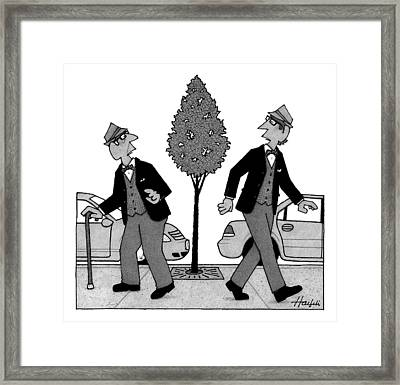 An Old Man And A Young Man Dressed Identically Framed Print