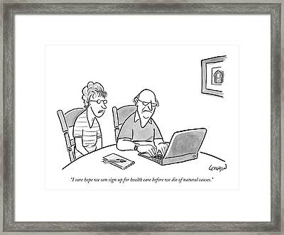 An Old Man And Old Woman Sit At A Laptop Framed Print