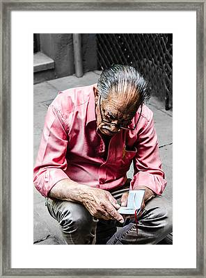 An Old Man Reading His Book Framed Print by Sotiris Filippou