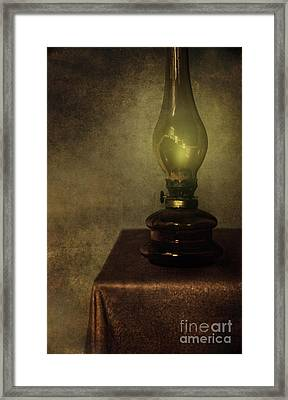 An Old Oil Lamp On The Table Framed Print