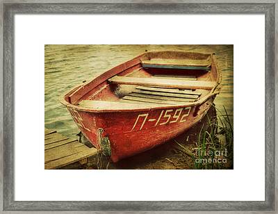 An Old Row Boat Framed Print by Emily Kay