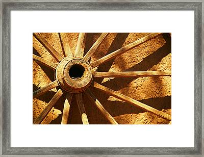 An Old Wagon Wheel In Carillos New Mexico Framed Print by Jeff Swan