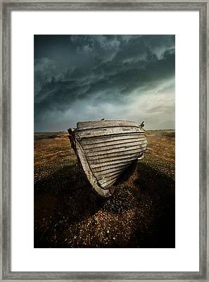 An Old Wreck On The Field. Dramatic Sky In The Background Framed Print