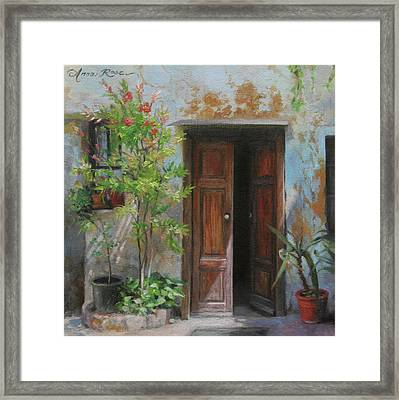 An Open Door Milan Italy Framed Print by Anna Rose Bain