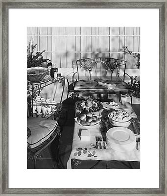 An Outdoor Dining Set Up Framed Print