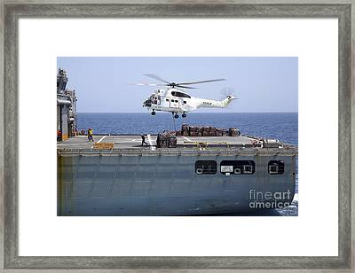 An Sa-330j Puma Helicopter Delivers Framed Print