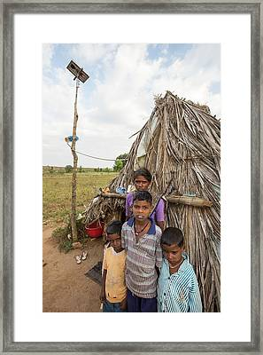 An Untouchable Family Outside Their Hut Framed Print by Ashley Cooper