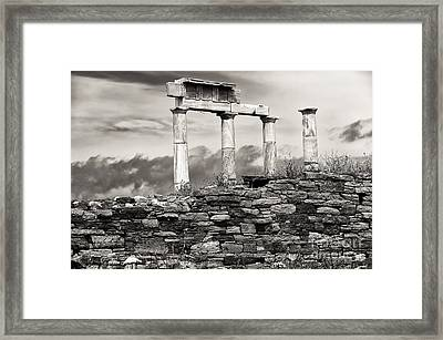 Ancient Columns On Delos Island Framed Print by John Rizzuto