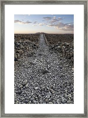 Ancient Rocky Road Leading To The Horizon. Framed Print by Edward Fielding