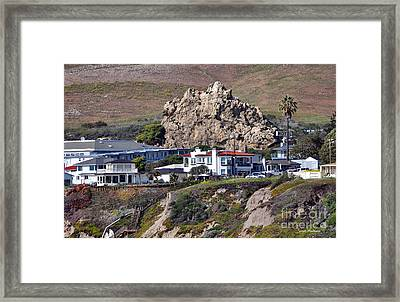 Ancient Sea Stack At Pismo Beach Above Motels Framed Print by Susan Wiedmann