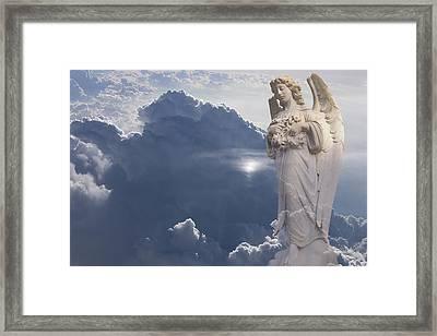 Angel In The Clouds Framed Print by Jim Zuckerman