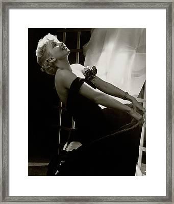 Ann Sothern Kneeling On An Armchair Framed Print