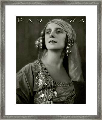 Anna Pavlova Wearing An Ornate Dress Framed Print by Eugene Hutchinson