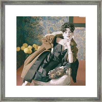 Anne St. Marie Wearing A Coat And Dress Framed Print by Horst P. Horst