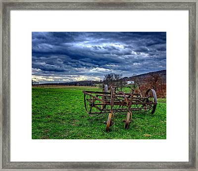 Antique Hay Rake Under As Stormy Sky Framed Print by Chris Bordeleau