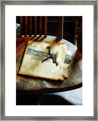 Framed Print featuring the photograph Antique Keys On Newspaper by Susan Savad