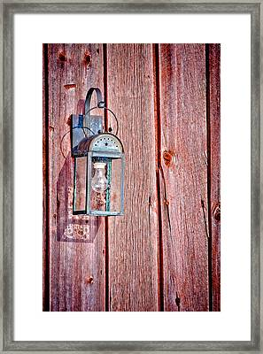 Antique Lantern On Weathered Red Barn Framed Print by Jeff Sinon