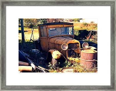 Antique Pick-up Truck Rusting Away Framed Print by Robert Birkenes
