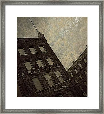 Antiques Warehouse  Framed Print by Chris Berry