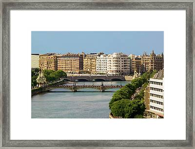 Apartment Buildings Line The River Framed Print