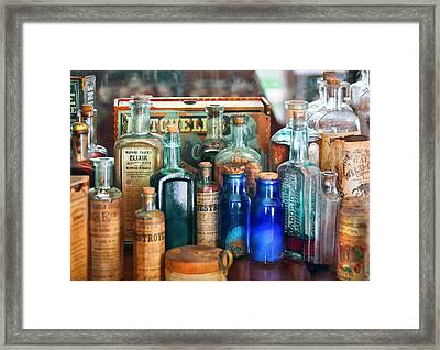 Apothecary - Remedies For The Fits Framed Print by Mike Savad