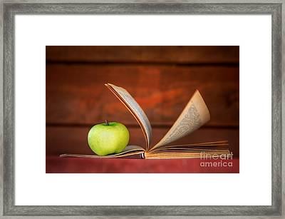 Apple And Book Framed Print by Michal Bednarek