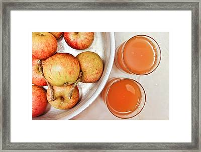 Apple Juice Framed Print by Tom Gowanlock